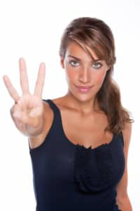 Beautiful Woman Holding Up 3 Fingers