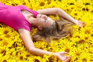 womanrelaxedsunflowers