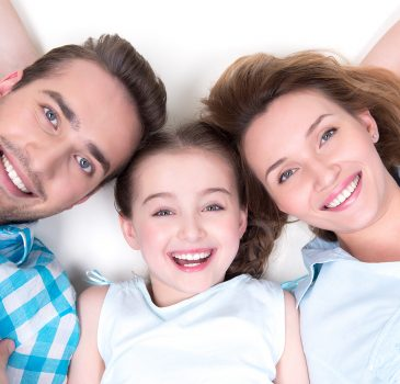 High angle portrait of caucasian happy smiling young family